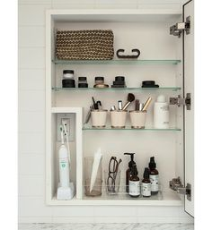 Inside the Medicine Cabinet…store things upright. Cups and containers that fit on those shallow shelves are game changers when organizing a medicine cabinet.