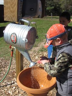 Outdoor hand washing station made from a watering can! Yes please!!