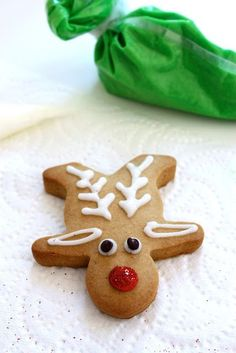 What a cute idea!! Turning a Gingerbread Man into Rudolf! A super easy recipe for both cookies & icing.