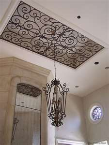 I love wrought iron, so why not on the ceiling? Living room...mount on ceiling and then put molding around it!!! AHHHHH LOVE!