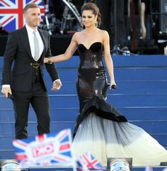 Simply stunning! Cheryl Cole donned an elegant strapless gown with a huge fishtail skirt (by Polish designer EWA MINGE) as she took to the stage with Gary Barlow at the Queen's Diamond Jubilee concert