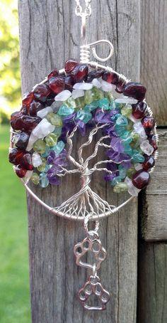 Rainbow Bridge themed tree of life pendant.  Stones include garnet, moonstone, peridot, apatite and amethyst.