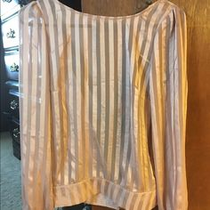 **NEW WITH TAGS Boutique shirt Light pink silk shirt. Never worn. Open back with black tie. Long sleeve Tops Blouses