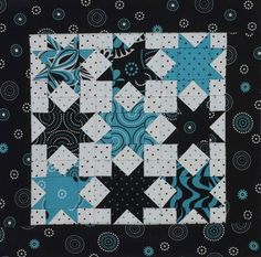 Play with scale and include small and medium prints in a cute table topper.  This three-color version uses fabrics from the Rhythm & Blues collection from  Red Rooster Fabrics.