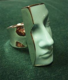 this is jewerly but I love the idea for a ceramic project! What if this was a book end and it was spilt down the middle?
