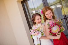 Bridal bouquet and godmother's bouquet with red protea by Atelier Floristic Aleksandra