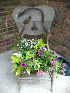 Look what I planted in my old chair this Spring! Look what I planted in my old chair this Spring! Old Wooden Chairs, Old Chairs, Painted Chairs, Antique Chairs, Garden Chairs, Garden Beds, Garden Art, Garden Whimsy, Garden Junk