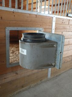 "Swing out doors with insulated bucket holders—my one ""splurge"" when we built the barn. Keeps water from freezing in winter!"