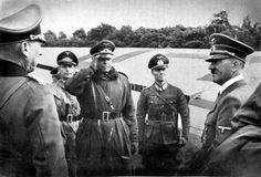 Hitler in Poland by Heinrich Hoffmann -- Air General Kesselring reported about military action - (von Küchler and Erwin Rommel can also be seen in the picture).