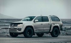 Volkswagen revealed a one-off Arctic Circle truck called the designed for carting around folks in the frigid wastelands of Iceland. The Amarok-based truck was customized by Arctic Trucks. Vw Pickup Truck, Chevy Trucks, Vw Amarok, 4x4 Ford Ranger, Truck Toppers, Chevy Models, Land Cruiser 200, Chevrolet Colorado, Car Restoration