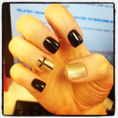 My fun nails! Acrylics with black gel polish, champagne sparkle gel polish and black rhinestones for the cross.