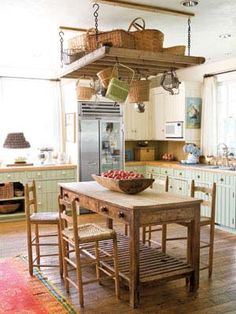 A Classic Country Kitchen     In this kitchen, sage and cream cabinetry is paired with butcher-block countertops and a marble backsplash.