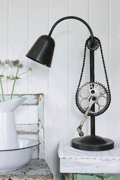 pipe table lamp with a bike gear and chain.  Super cool.