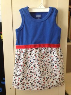 Toddler dress for July 4th. I made this by adding a skirt to a store bought tank top. Ribbon around the center adds a pop of color and hides the seam.
