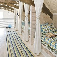 Adorable idea for guests/children. Bunk style beds in a row w/drapes.