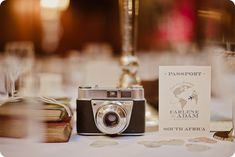 Table decorations for a vintage travel themed wedding