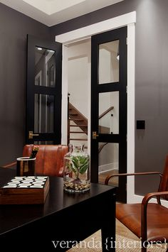 Black interior doors with white trim - love!!  Entry way into computer room