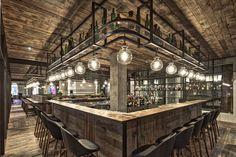 Mercato Restaurant (Shanghai) designed by Neri&Hu. Via the Retail Design Blog - above bar storage