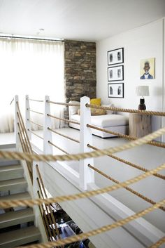 The rope idea is interesting especially for a vintage nautical theme. I like the idea of a sitting area at the top of the stairs too but I think I would arrange it a little different. Good inspiration