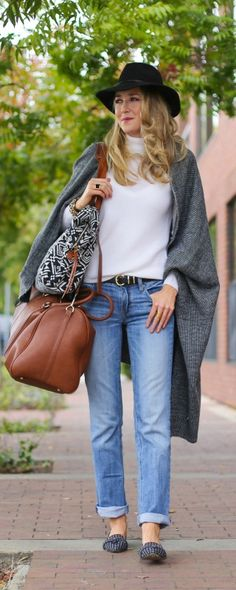 ivory mock neck turtleneck sweater, black hat, windowpane loafers, black and white poncho, print tote travel bag + brown vegan leather weekender bag  |  http://www.theclassycubicle.com/2014/11/travel-style.html