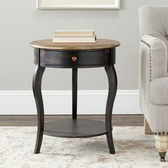 Incorporate a vintage look to your home with this Emma wooden antique round side table. Petite and classy, this table stands 24 inches tall and includes a French Louis XI drawer. The dark black base with walnut finish completes the piece.