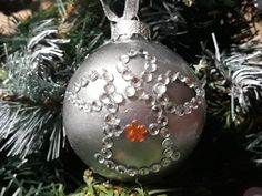 DIY Christmas tree ornament.  Clear crystal ball painted inside  with metallic silver nail polish and decorated as an angel with crystal stickers.