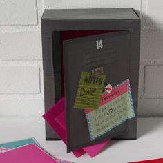 The cutest Valentine's Day card box idea with Mod Podge - use a upcycled cardboard box to decoupage scrapbook paper and create a mini locker!