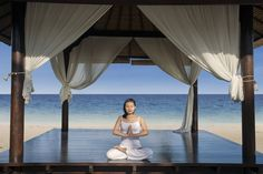Photo about Asian woman practice yoga at luxury beach resort, Indonesia. Image of ocean, legs, outdoor - 30821216 Luxury Beach Resorts, Beaches In The World, Phuket, Best Hotels, Asian Woman, Thailand, Stock Photos, Lifestyle, Poisons