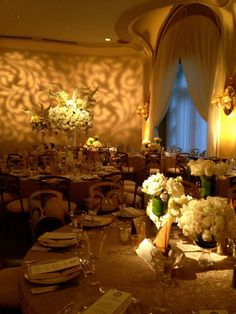 LOVE the crazy branches sticking out of the top of the tall centerpiece and the varied heights/sizes of the lower centerpieces