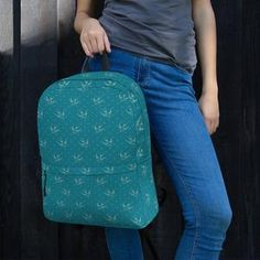 This Women's turquoise bird Backpack is just what you need for daily use or sports activities! The pockets (including one for your laptop) give plenty of room for all your necessities, while the water-resistant material will protect them from the weather. Sports Activities, Are You The One, Louis Vuitton Monogram, Laptop, Weather, Backpacks, Turquoise, Pockets, Bird