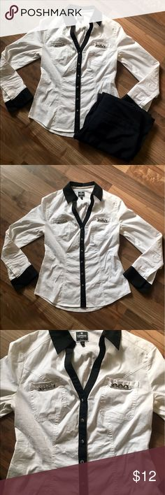⭐️NEW LISTING⭐️ Express Essential Button Up Blouse Classy black and white colored Express blouse. Has some metal accent pieces on the pockets. No stains that I see; only worn once or twice. 30% off bundle with purchase of 3+ items. ♥️ Express Tops Button Down Shirts