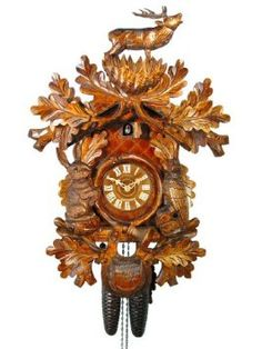Amazon.com: German Cuckoo Clock 8-day-movement Carved-Style 22 inch - Authentic black forest cuckoo clock by August Schwer: Home & Kitchen