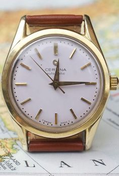 Simple vintage watch. Certina Brown Leather Watch 2012 via Esquire