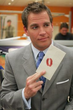 He probably should NOT open that envelope....but he will cause he's Dinozzo