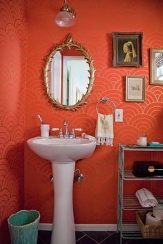 Gorgeous || tangerine & gold scallop wallpaper- and that garbage can :)