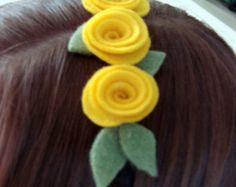 felt rosettes on a fabric wrapped hairband