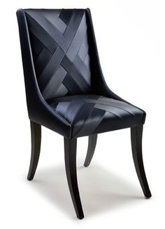 A stunning dressing or dining chair shown in deep blue metallic vinyl with meticulously hand cut and stiched seams.
