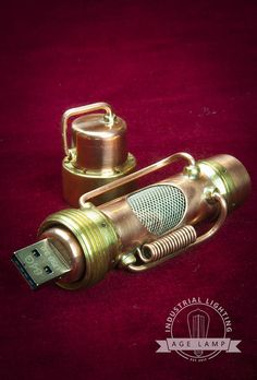 This steampunk modified USB drive is made with brass, copper, glass and stainless mesh. The metal connections are brazed with silver. This is very strongly built with a nice solid, heavy feel. This is a very rugged piece that will not be coming apart. The interior glows blue while plugged in and flashes while transferring data. The cap screws on securely and has a bale to attach a lanyard or use it as a pendant. This drive uses the new 3.0 style circuit card, holds 64 gigabytes and read…