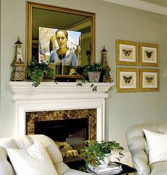 Technology can work in favor of a room's decor. At first glance an oversize mirror hangs above the fireplace. However, when the set is turned on, the TV screen can be seen clearly through the mirror's transparent surface..amazing!