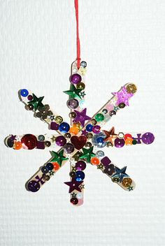Christmas star made with popsicle sticks.  The kids could do this.