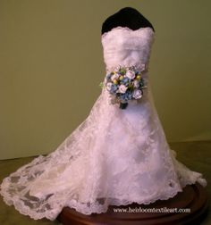 replica of actual wedding gown and bouquet...just under 11 inches tall!