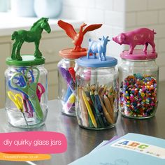 random farm animals + spray paint + jar = cute storage for little craft supplies!  I would probably try to use clear plastic jars instead of glass