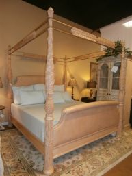 Price: $525.95  Item #: 124502 King sized canopy bed in carved wood and rattan. Perfect.