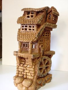 Bark carving water wheel by Reynold Brix