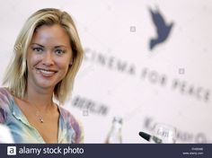 Download this stock image: epa00638114 The US American Kristanna Loken smiles during a press conference on the charity gala 'Cinema for Peace' at the 56th International Berlinale Film Festival in Berlin, Sunday 12 February 2006. The benefits generated from the event taking place on 13 February 2006 will be donated to UNICEF.  EPA/Jan Woitas - FH5EMB from Alamy's library of millions of high resolution stock photos, illustrations and vectors.