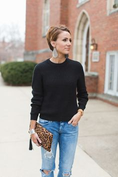 Punch up basic black with a little leopard and a statement earring.