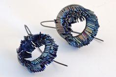 heather woof - windswept earrings 2012 - hand cut titanium and mild steel.