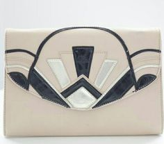 Great Gatsby-inspired Clutch Elegant yet trendy, this clutch features black and silver design against blush pink faux leather. Very good condition. Slight stain on back corner. Bags Clutches & Wristlets