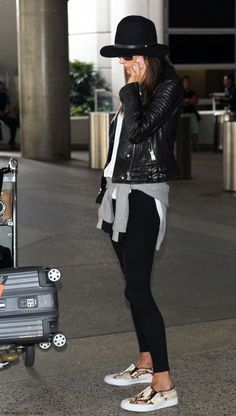 Flight outfit - Black tights, grey cardigan, white tee, black leather jacket, black hat, slip ons