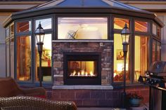 Hearth & Home Technologies Twilight Modern Indoor/Outdoor Fireplace OMG. this is the most awesome thing I have ever seen with a fireplace. If I ever build a house.this will be a requirement. Outdoor Gas Fireplace, Indoor Outdoor Fireplaces, Outside Fireplace, Concrete Fireplace, Farmhouse Fireplace, Fireplace Design, Fireplace Ideas, Modern Fireplace, Gas Fireplaces